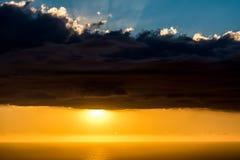 Nuvens sobre o sol Foto de Stock