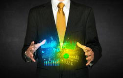 Nuvola del diagramma della tenuta dell'uomo d'affari Fotografia Stock