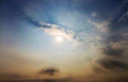 Nuvola e sole Fotografia Stock