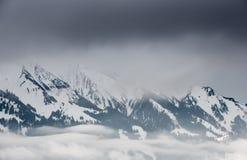 Nuvole in alpi svizzere nell'inverno Fotografia Stock Libera da Diritti