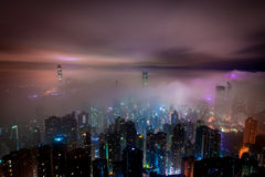 Nuvole e città lustrate Fotografia Stock Libera da Diritti