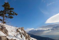 Nuvole e montagne Fotografia Stock