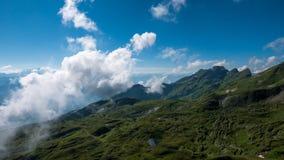 Nuvole e montagne in Svizzera Immagine Stock