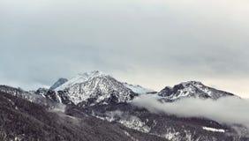 Nuvole intorno alle alpi durante l'inverno Fotografia Stock Libera da Diritti