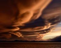 Nuvole lenticolari al tramonto Immagine Stock