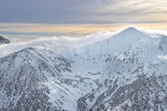 Nuvole sopra Kasprowy Wierch in Zakopane in Tatras nell'inverno Fotografie Stock Libere da Diritti