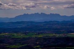 Nuvole sulle montagne di Montserrat Immagine Stock