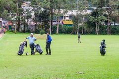 NUWARA ELIYA, SRI LANKA - JULY 17, 2016: Golf players at Victoria Golf Club in Nuwara Eliya tow stock photography