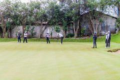 NUWARA ELIYA, SRI LANKA - JULY 17, 2016: Golf players at Victoria Golf Club in Nuwara Eliya tow stock photos