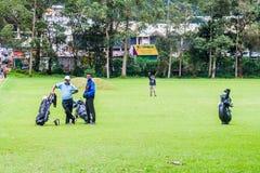 NUWARA ELIYA, SRI LANKA - JULY 17, 2016: Golf players at Victoria Golf Club in Nuwara Eliya tow stock image
