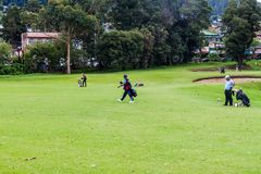 NUWARA ELIYA, SRI LANKA - JULY 17, 2016: Golf players at Victoria Golf Club in Nuwara Eliya tow stock images