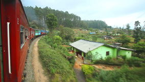 NUWARA ELIYA, SRI LANKA - MARCH 2014: View of the Nuwara Eliya countryside from the moving train. The Sri Lankan railway transport. S millions of people daily in stock video