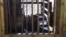 NUWARA ELIYA, SRI LANKA - MARCH 2014: The view of a train engine in Nuwara Eliya. The Sri Lankan railway transports millions of pe stock footage