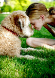 Nuzzle Noses. A cute little girl and her dog with their noses together stock image