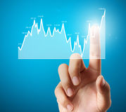 Nvestment concept with financial chart symbols coming from hand Stock Photo