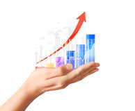 Nvestment concept with financial chart symbols coming from hand. Nvestment concept with financial chart symbols coming from a hand Royalty Free Stock Image