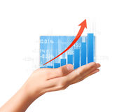 Nvestment concept with financial chart symbols coming from hand. Nvestment concept with financial chart symbols coming from a hand Royalty Free Stock Photos
