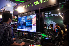 Nvidia in Indo Game Show 2013. Jakarta, Indonesia, 8th September 2013: Visitors experiencing latest GPU technologies from Nvidia in Indo Game Show 2013 event in Royalty Free Stock Photography