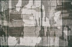 Vintage black and white gray abstract background with old cracked paint textured, camouflage. royalty free stock photo