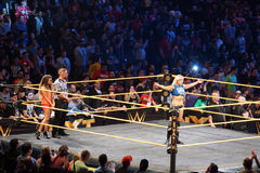 NXT Female wrestlers Charlotte Flair stands in ring with arms ex Stock Images