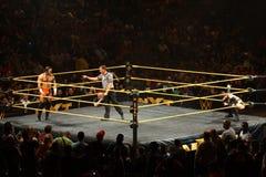 NXT male wrestler Adrian Neville stares across ring at Finn Balo Stock Photography