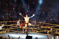 NXT male wrestler Finn Balor opens arms as he stands on ropes wh. SAN JOSE - MARCH 27: NXT male wrestler Finn Balor opens arms as he stands on ropes while crowd Stock Photography