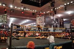 NXT Wrestle Bull Dempsey jump off ropes on to opponent Jason Jor Royalty Free Stock Image