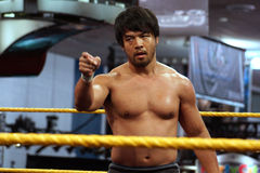 NXT Wrestle Hideo Itami points across ring during match Royalty Free Stock Image