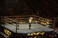NXT Wrestle Sami Zayn pumps up crowd as he talks into microphone Stock Photo