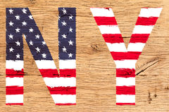 NY绘与旗子美国老橡木的样式 库存照片