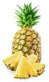 Ny ananas med skivor som isoleras på vit royaltyfria bilder