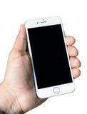 Ny Apple iPhone 6 i den isolerade handen Arkivfoto