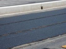 Ny asfalt Arkivbild