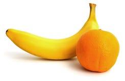 Ny banan och orange Fotografering för Bildbyråer