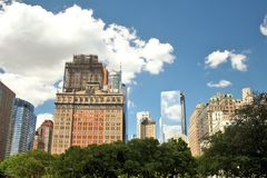 NY City skyline with a mixture of vintage and modern buildings. And a blue sky background Stock Photos