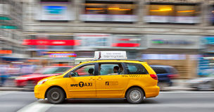 NY City yellow taxi. NEW YORK CITY - September 25: Taxi hurryies tourists to their destination in Manhattan on September 25, 2011 in New York, NY Royalty Free Stock Image