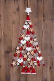 Ny design för en röd och vit garnering för julträd - royaltyfria foton