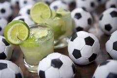 Ny för Caipirinhas för limefrukt två fotboll brasilian Fotografering för Bildbyråer