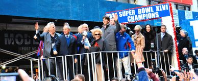 NY Giants Victory Parade. Eli Manning, Steve Tisch, NY Mayor Bloomberg, Jonathan Tisch and Ann Mara (holding the Lombardi Trophy) during NY Giants ticker-tape stock image