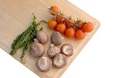 Ny glad tomatchampinjon och ny peppar jpg Royaltyfri Fotografi