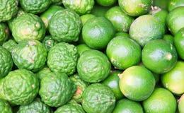 Ny grön citronlimefruktbakgrund Royaltyfri Fotografi