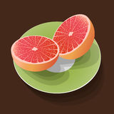 Ny grapefrukt på den gröna plattan Fotografering för Bildbyråer