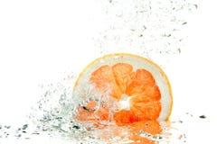 Ny grapefruktfärgstänk Arkivfoto