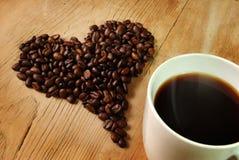 ny hjärta för bönakaffe arkivbild