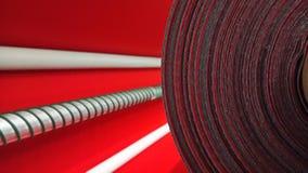 Ny industriell röd rulle, röd bakgrund Begrepp: material tyg, tillverkning, plaggfabrik, nya prövkopior av tyger fotografering för bildbyråer