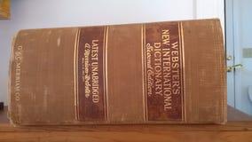 """Ny internationell ordbok för Webster ` s, bok för andra upplaga, USA Ð """", Arkivfoto"""