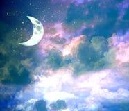Ny måne på blå himmel för afton med glänsande stjärnor arkivbild