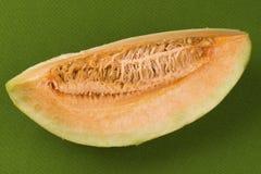 Ny melon med en skiva Arkivfoton