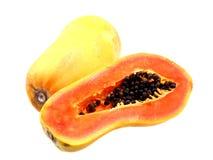 Ny och mogen papaya Arkivfoto