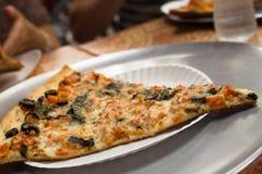 NY Pizza. Slice of traditional New York Style pizza Stock Photos